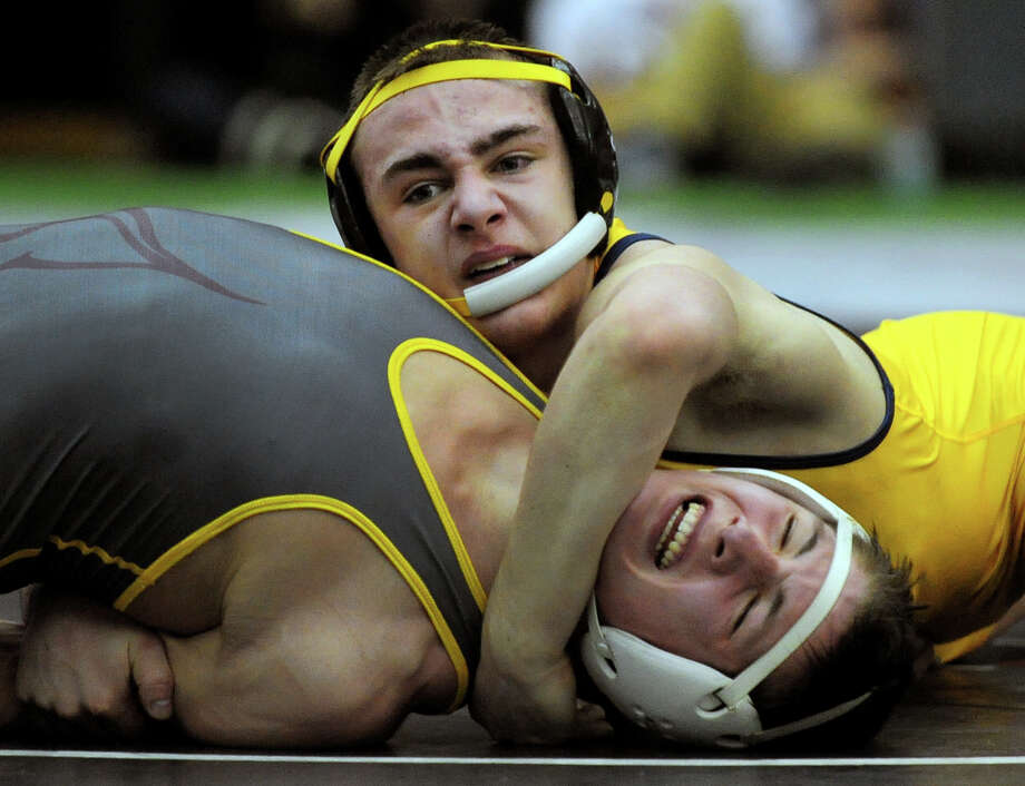 Newtown's Anthony Falbo works to pin South Windsor's Max Odell, during State Open Wrestling Championship action at Hillhouse High School's Floyd Little Athletic Center in New Haven, Conn. on Saturday March 1, 2014. Photo: Christian Abraham / Connecticut Post