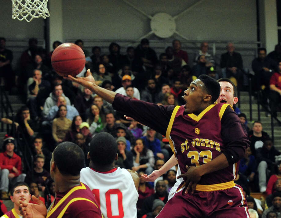 St. Joseph's Arkel Ager-Lamar looks for two points, during FCIAC Boys' Basketball Quarterfinal action against Central at Fairfield Ludlowe High School in Fairfield, Conn. on Saturday March 1, 2014. Photo: Christian Abraham / Connecticut Post