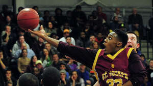 St. Joseph's Arkel Ager-Lamar looks for two points, during FCIAC Boys' Basketball Quarterfinal action against Central at Fairfield Ludlowe High School in Fairfield, Conn. on Saturday March 1, 2014.