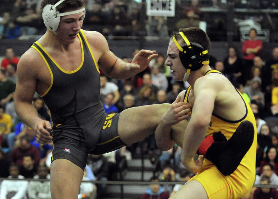 Newtown's Anthony Falbo, right, wrestles against South Windsor's Max Odell, during State Open Wrestling Championship action at Hillhouse High School's Floyd Little Athletic Center in New Haven, Conn. on Saturday March 1, 2014. Photo: Christian Abraham / Connecticut Post