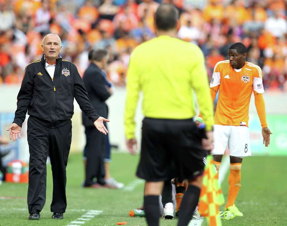 Houston Dynamo head coach Dominic Kinnear left, call out to an official as Houston Dynamo defender Kofi Sarkodie right, looks on during the second half of the MLS Eastern Conference Final game against the Sporting KC at BBVA Compass Stadium Saturday, Nov. 9, 2013, in Houston.  ( James Nielsen / Houston Chronicle ) Photo: James Nielsen, Staff / © 2013  Houston Chronicle