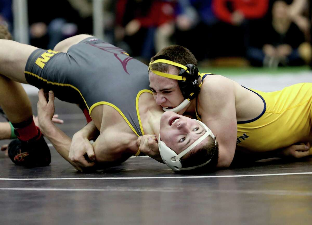 Newtown High School's Anthony Falbo leads his 152 lb weight class match-up against Max Odell of South Windsor High School during Saturday evening State Open Wrestling Championships at New Haven Floyd Little Athletic Center.