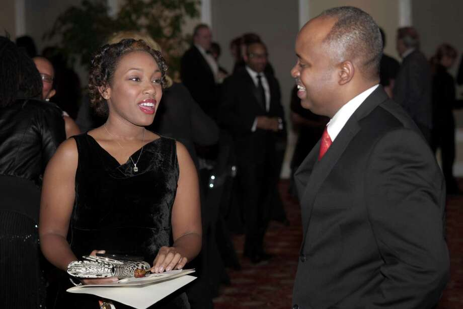 Candice Dolberry, of Danbury, talks with Horland Harris, of Danbury,  during the Hord Foundation 20th Anniversary Gala at the Amber Room Colonnade, Danbury, Conn, on Saturday night, March 1, 2014. Photo: H John Voorhees III / The News-Times Freelance