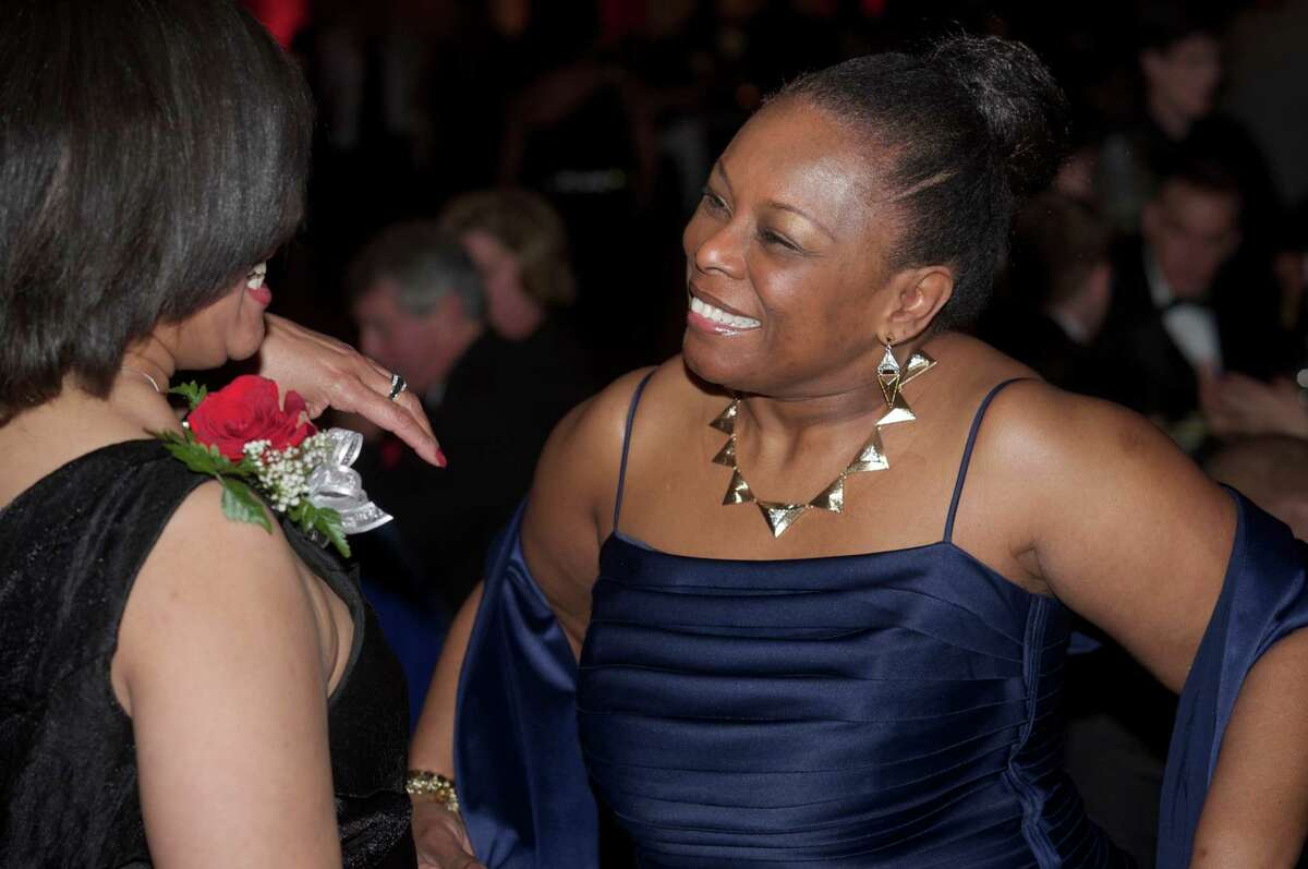 Cynthia Holmes, of Danbury, right, talks with Diane Moxley during the Hord Foundation 20th Anniversary Gala at the Amber Room Colonnade, Danbury, Conn, on Saturday night, March 1, 2014.