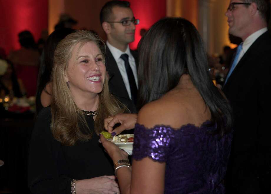 Lisa Esneault, of Brookfield, left, talks with Vanessa Abrahams-John, of White Plains NY,  during the Hord Foundation 20th Anniversary Gala at the Amber Room Colonnade, Danbury, Conn, on Saturday night, March 1, 2014. Photo: H John Voorhees III / The News-Times Freelance