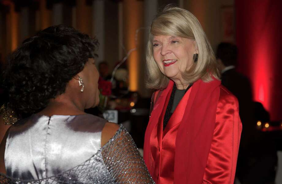 Gala honoree Christine Lodewick, of Ridgefield, talks with Lauren Williams, of Danbury, during the  Hord Foundation 20th Anniversary Gala at the Amber Room Colonnade, Danbury, Conn, on Saturday night, March 1, 2014. Photo: H John Voorhees III / The News-Times Freelance
