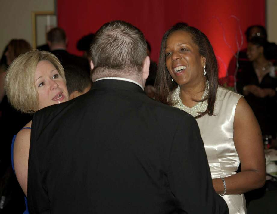 Michelle and Ed James, of Danbury,Heather Morgado, of Southbury, left, Chris Bailey, of Peekskill NY, and Dawn Speed, of Peekskill NY, share a laugh during the Hord Foundation 20th Anniversary Gala at the Amber Room Colonnade, Danbury, Conn, on Saturday night, March 1, 2014. Photo: H John Voorhees III / The News-Times Freelance