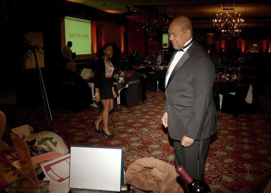 Livie Spearman, of Cheshire, looks over the items up for silent auction during the Hord Foundation 20th Anniversary Gala at the Amber Room Colonnade, Danbury, Conn, on Saturday night, March 1, 2014. Photo: H John Voorhees III / The News-Times Freelance