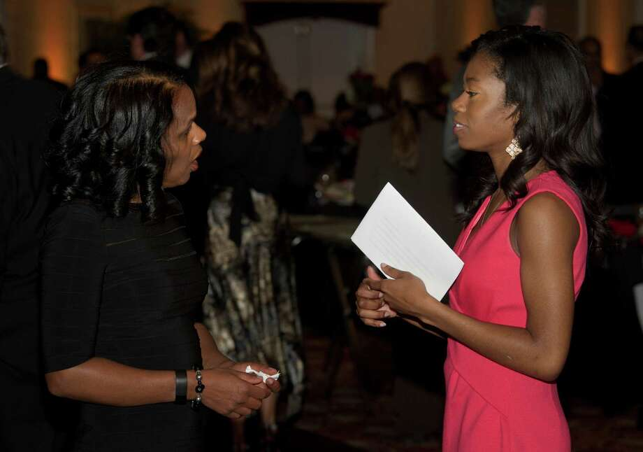 Faye Walton, of Danbury, left, talks with Vanessa Kalu, age 18, of Baltimore Maryland, during the Hord Foundation 20th Anniversary Gala at the Amber Room Colonnade, Danbury, Conn, on Saturday night, March 1, 2014. Kalu is a Hord Scholar who is attending Carnegie Mellon University. Photo: H John Voorhees III / The News-Times Freelance
