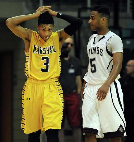 Marshall's Jadier Richardson (3) reacts after a foul was called on his squad late in the second half
