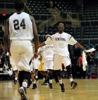 Beaumont Central players celebrate their 67-57 victory over Marshall in the Class 4A Region 3 Final high school basketball playoff game, Saturday, March 1, 2014, at Merrill Center in Katy, TX. Photo: Eric Christian Smith, For The Chronicle