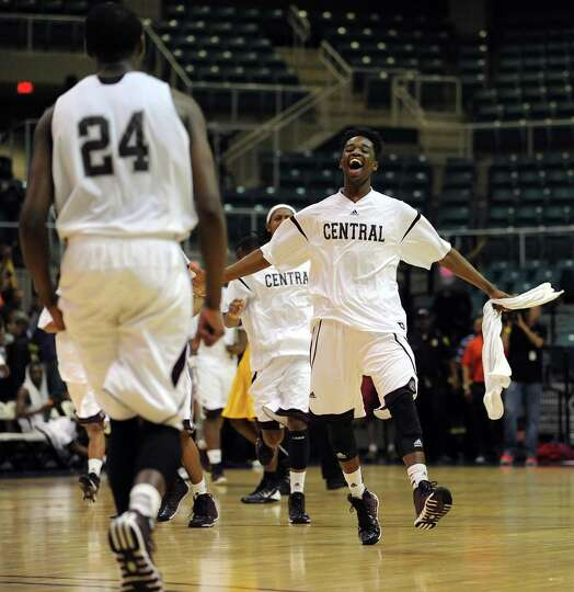 Beaumont Central players celebrate their 67-57 victory over Marshall in the Class 4A Region 3 Final
