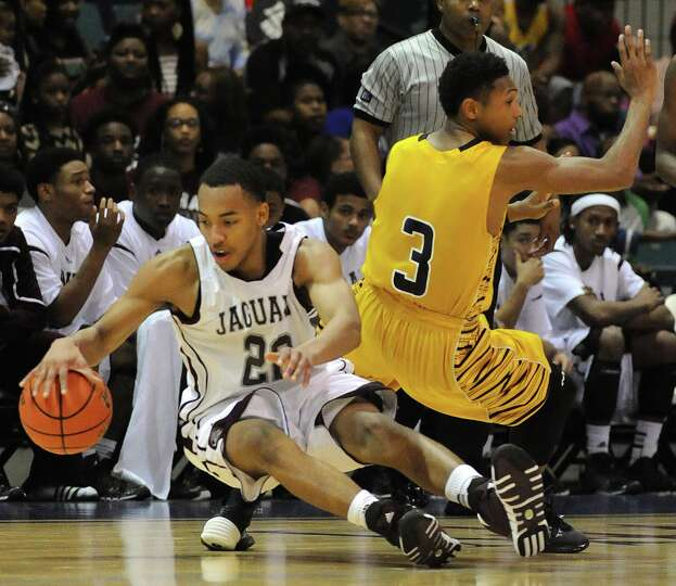 Beaumont Central'sNijal Pearson, left, falls down after bumping Marshall's Jadier Richardson during