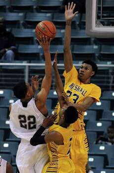 Marshall's Keondre Gibson, right, and teammate Jadier Richardson, center, block the shot of Beaumont Central's Nijal Pearson during the first half of the Class 4A Region 3 Final high school basketball playoff game, Saturday, March 1, 2014, at Merrill Center in Katy, TX. Photo: Eric Christian Smith, For The Chronicle