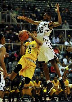Marshall's Jeremy Smith, left, drives to the basket as Beaumont Central's Andre' Morris defends during the first half of the Class 4A Region 3 Final high school basketball playoff game, Saturday, March 1, 2014, at Merrill Center in Katy, TX. Photo: Eric Christian Smith, For The Chronicle