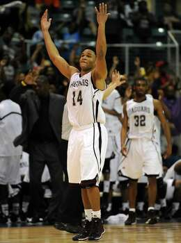 Beaumont Central's Garrison Mitchell (14) celebrates in the final moments of the Jaguars' 67-57 victory over Marshallduring the second half of the Class 4A Region 3 Final high school basketball playoff game against Marshall, Saturday, March 1, 2014, at Merrill Center in Katy, TX. Photo: Eric Christian Smith, For The Chronicle