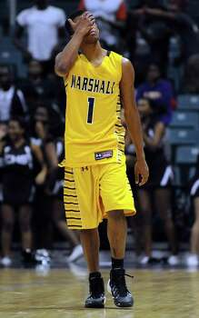 Marshall's Oscar Wilhite covers his face in defeat in the waning moments of Marshall's 67-57 defeat to Beaumont Central during the second half of the Class 4A Region 3 Final high school basketball playoff game, Saturday, March 1, 2014, at Merrill Center in Katy, TX. Photo: Eric Christian Smith, For The Chronicle