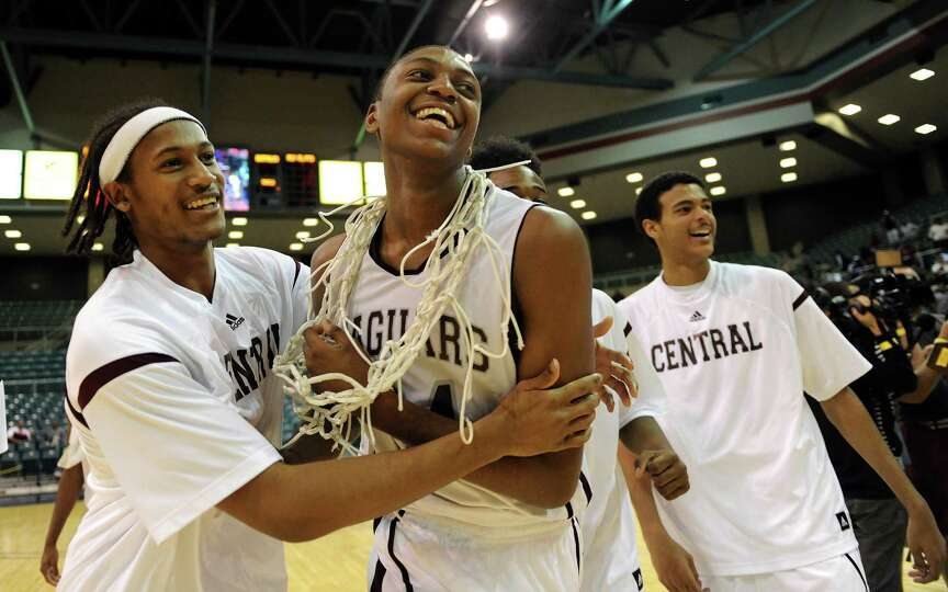 Beaumont Central's E'Torrion Wilridge, center, celebrates the Jaguars' 67-57 victory over Marshall a
