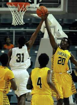 Marshall's Christian Barrett (20) blocks the shot of Beaumont Central's Michael Jacquet during the first half of the Class 4A Region 3 Final high school basketball playoff game, Saturday, March 1, 2014, at Merrill Center in Katy, TX. Photo: Eric Christian Smith, For The Chronicle