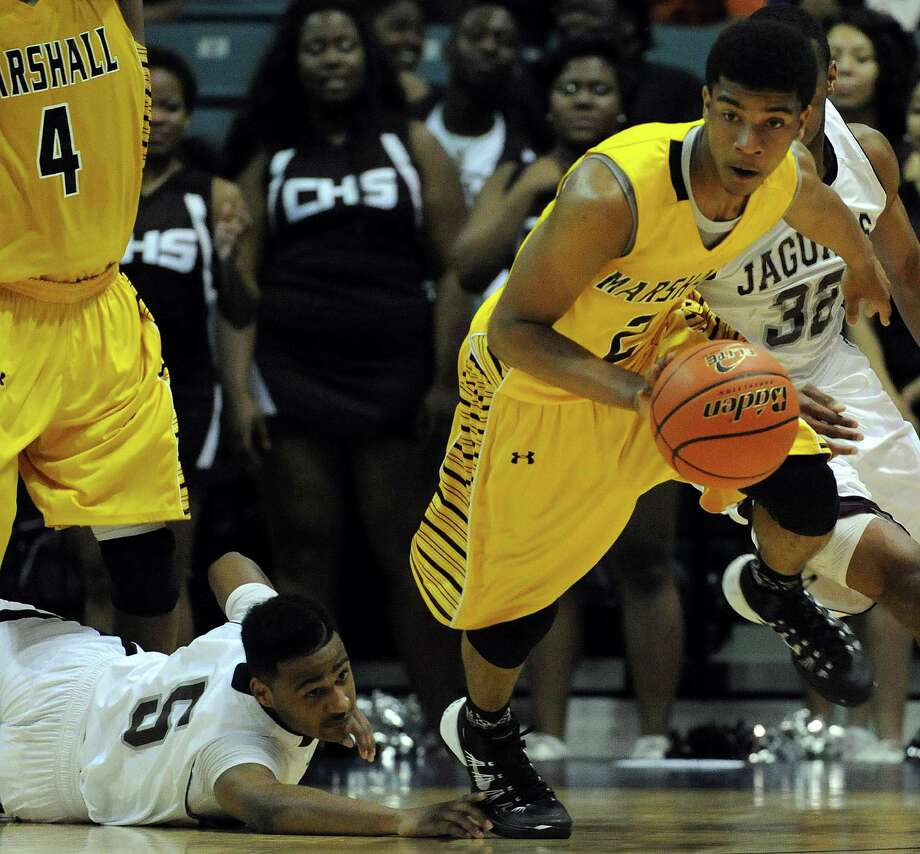 Marshall's Jeremy Smith, right, dribbles past Beaumont Central's Jacory Guillory during the second half of the Class 4A Region 3 Final high school basketball playoff game, Saturday, March 1, 2014, at Merrill Center in Katy, TX. Photo: Eric Christian Smith, For The Chronicle