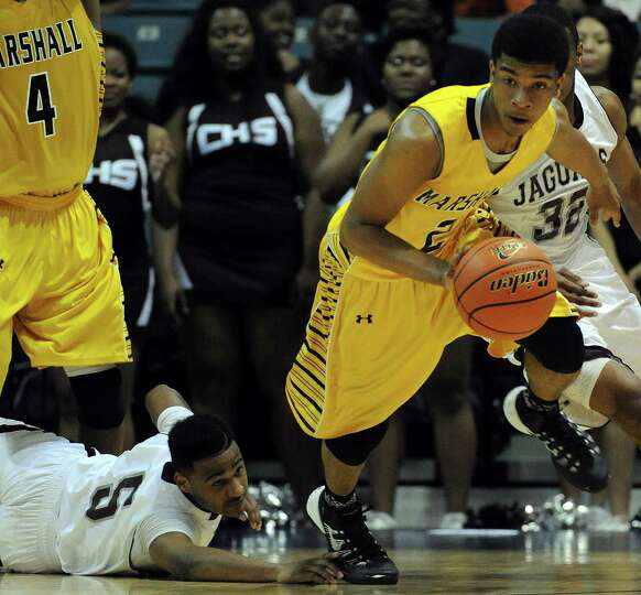 Marshall's Jeremy Smith, right, dribbles past Beaumont Central's Jacory Guillory during the second h