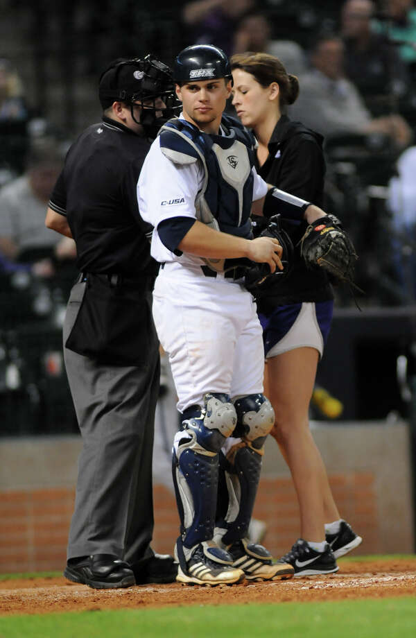 Rice catcher John Clay Reeves acknowledges a ribbing from his teammates after trying to leave the field after only two outs in the top of the third inning of their game versus the TCU Horned Frogs in their Saturday night matchup at the Houston College Classic at Minute Maid Park. Photo: Jerry Baker, For The Chronicle