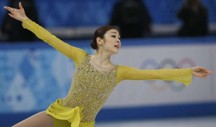 "BEST: South Korea's Yuna Kim radiates quiet elegance in a chartreuse, beautifully fitted dress with beaded torso and bell sleeves during the women's short program Feb. 19, to the music ""Where are the Clowns?"" (Photo Alexander Demianchuk) Photo: ALEXANDER DEMIANCHUK, Reuters"