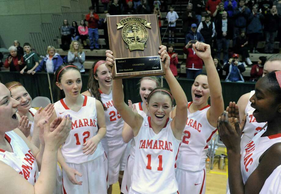 Tamarac's Jenna Erickson, center, celebrates with teammates after defeating Johnstown in the Section 2 Class B girl's final at HVCC on Saturday March 1, 2014 in Troy, N.Y. (Michael P. Farrell/Times Union) Photo: Michael P. Farrell / 00025935A