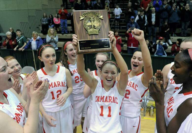 Tamarac's Jenna Erickson, center, celebrates with teammates after defeating Johnstown in the Section