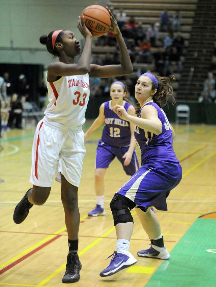 Tamarac's Adiya Henderson goes in for a score during their Section 2 Class B girl's final against Johnstown at HVCC on Saturday March 1, 2014 in Troy, N.Y. (Michael P. Farrell/Times Union) Photo: Michael P. Farrell / 00025935A