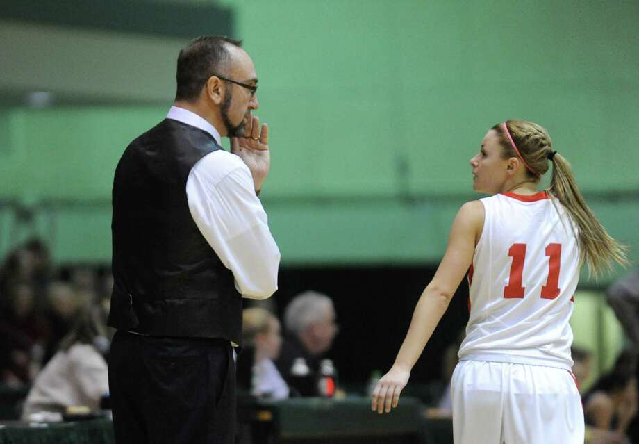 Tamarac head coach Eric Medved talks player Jenna Erickson during their Section 2 Class B girl's final against Johnstown at HVCC on Saturday March 1, 2014 in Troy, N.Y. (Michael P. Farrell/Times Union) Photo: Michael P. Farrell / 00025935A
