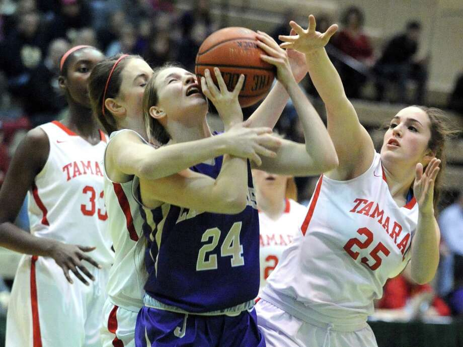 Johnstown's Hope Cirillo is smothered by the Tamarac defence during their Section 2 Class B girl's final at HVCC on Saturday March 1, 2014 in Troy, N.Y. (Michael P. Farrell/Times Union) Photo: Michael P. Farrell / 00025935A