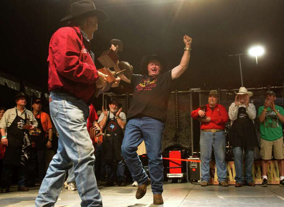 Jamie Geer reacts after the BBQ Commanders 3 won overall grand champion at the barbecue cookoff. The crew already aims to compete in the Jack Daniels World Championship Invitational in Tennessee. Photo: Brett Coomer, Staff / © 2014 Houston Chronicle