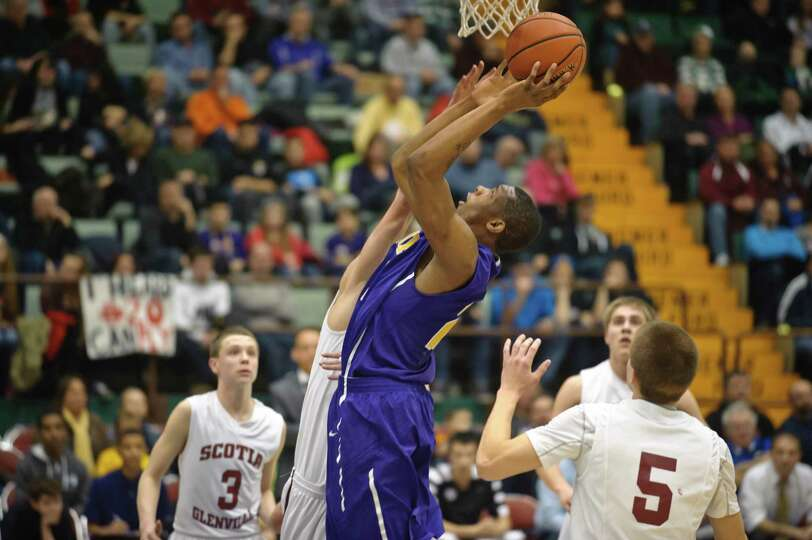 Troy's Justice Walston goes for a basket against Scotia Glenville players during the Section II Clas