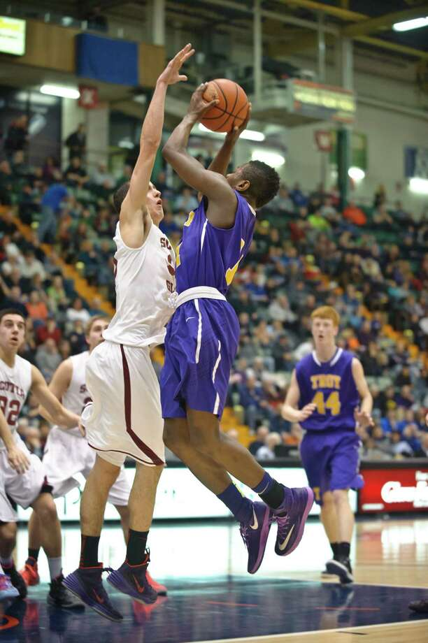 Troy's Dyaire Holt goes up for a basket against Scotia Glenville's Mike Palleschi during the Section II Class A final at the Glens Falls Civic Center Saturday evening, March 1st, 2014. Photo by Eric Jenks Photo: Eric Jenks / Eric Jenks 2012