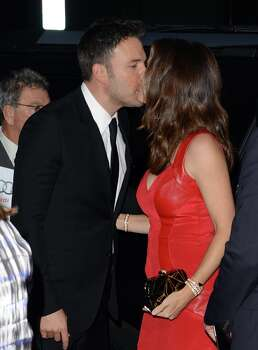 "Actors Ben Affleck (L) and Jennifer Garner sneak a kiss at the premiere of ""Argo"" in 2012. The couple met while filming ""Daredevil"" in 2003, while he was dating Jennifer Lopez and she was married to her former ""Felicity"" costar Scott Foley. They started dating in 2004 and were married the next year. They have three kids, Violet, Seraphina and Samuel. Photo: Jason Merritt, Getty Images / 2012 Getty Images"