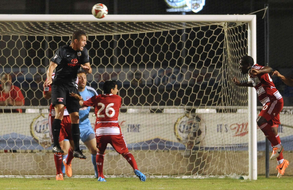 San Antonio Scorpions defender Greg Janicki heads the ball away from the goal during a soccer friendly against FC Dallas at Toyota Field Saturday, March 1, 2014.