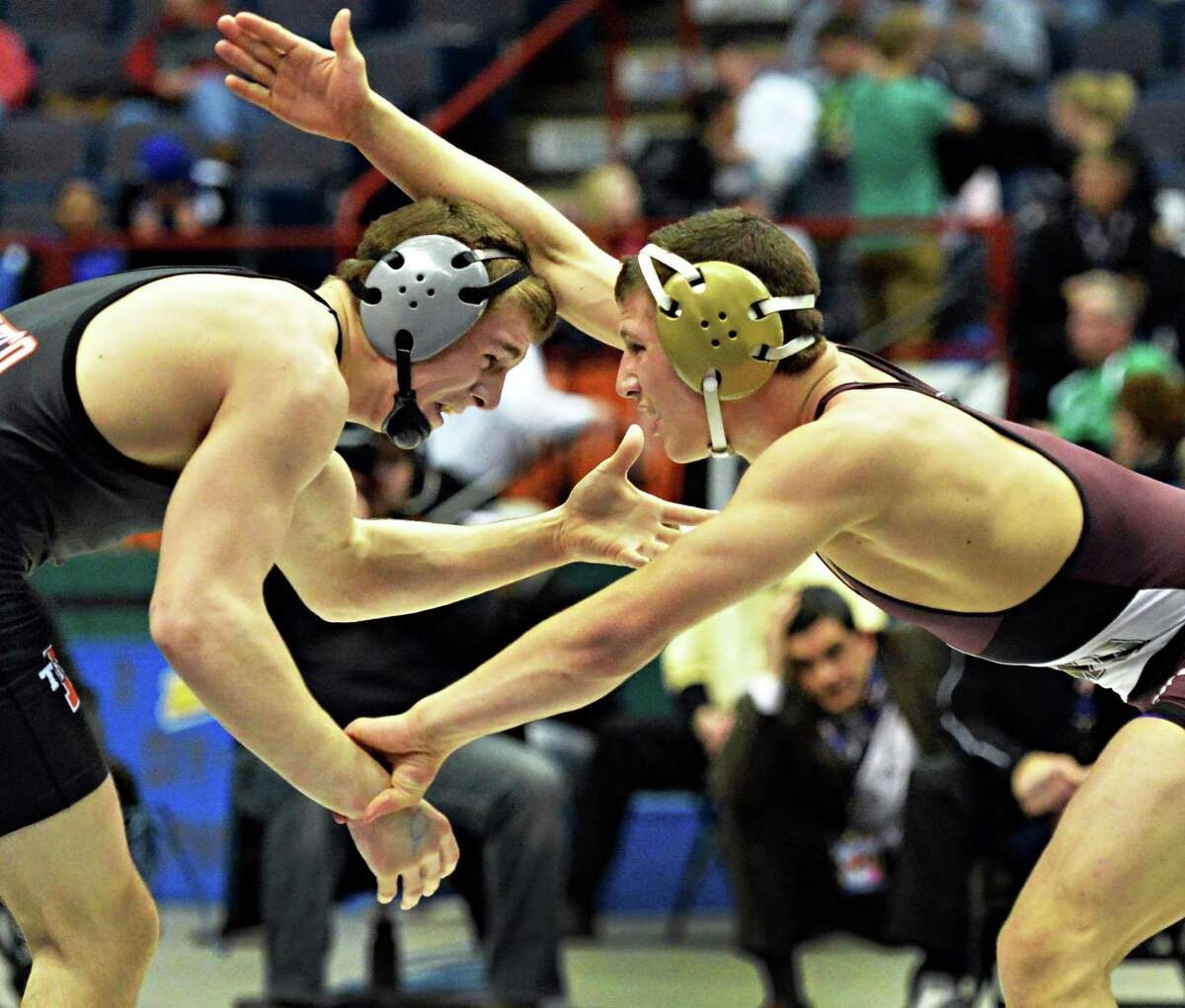 Duanesburg's Connor Larence, right, wrestles Mexico's Trevor Allard during the NY State Wrestling Championships Saturdy March 1, 2014, at the Times Union Center in Albany, NY. (John Carl D'Annibale / Times Union)