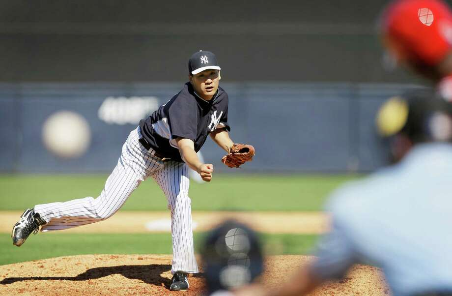 Highly touted offseason acquisition Masahiro Tanaka enjoyed a successful spring training debut Saturday, tossing two scoreless innings for the Yankees. Photo: Charlie Neibergall, STF / AP