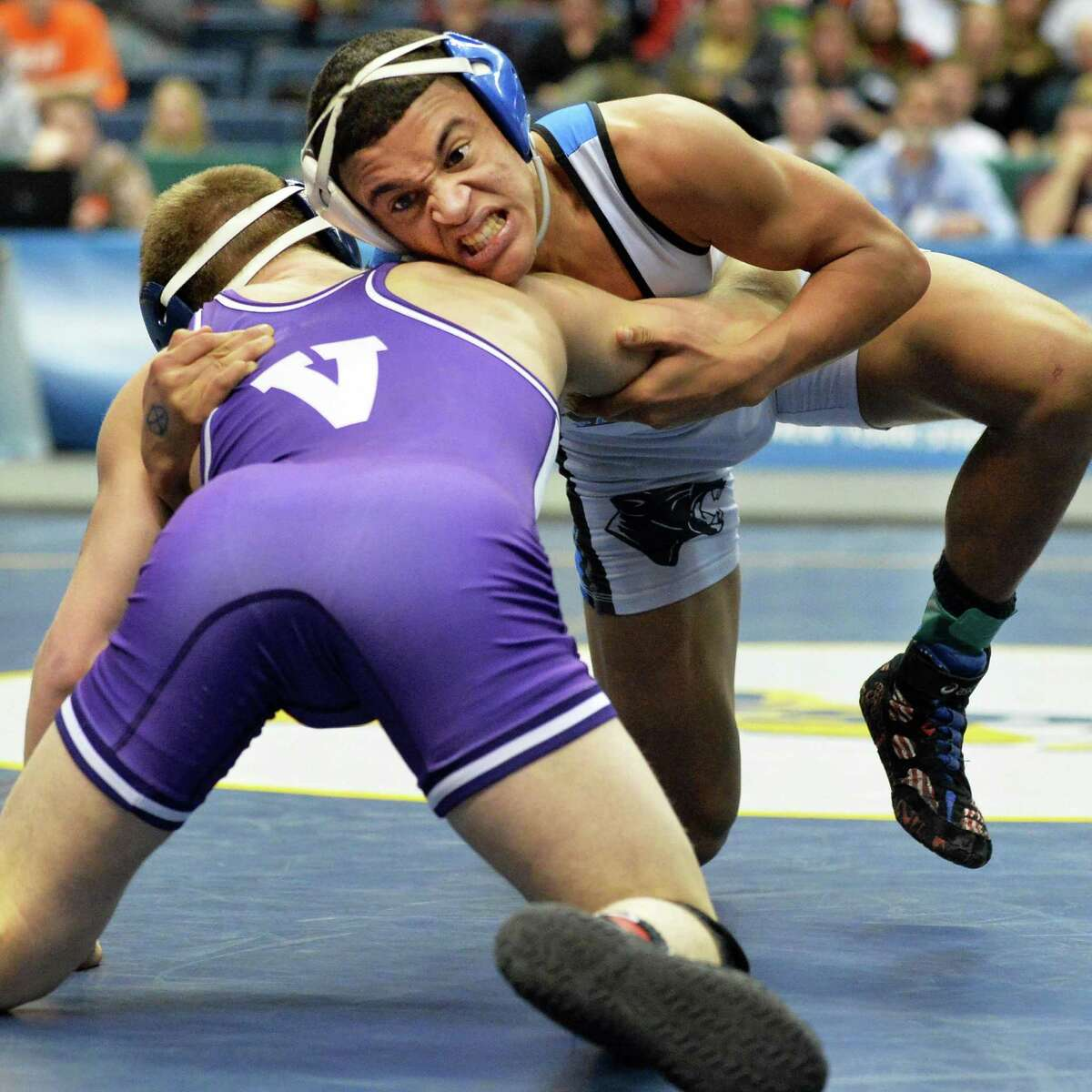 Hoosick Falls' Luis Weierbach, top, battles Wayne's Bryan Lantry during the NY State Wrestling Championships Saturdy March 1, 2014, at the Times Union Center in Albany, NY. (John Carl D'Annibale / Times Union)