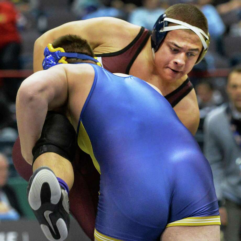 Cohoes' Nick Scott, top, wrestles Alfred-Almond's Connor Calkins at 285lbs. during the NY State Wrestling Championships Saturday March 1, 2014, at the Times Union Center in Albany, NY. (John Carl D'Annibale / Times Union) Photo: John Carl D'Annibale / 00025918A