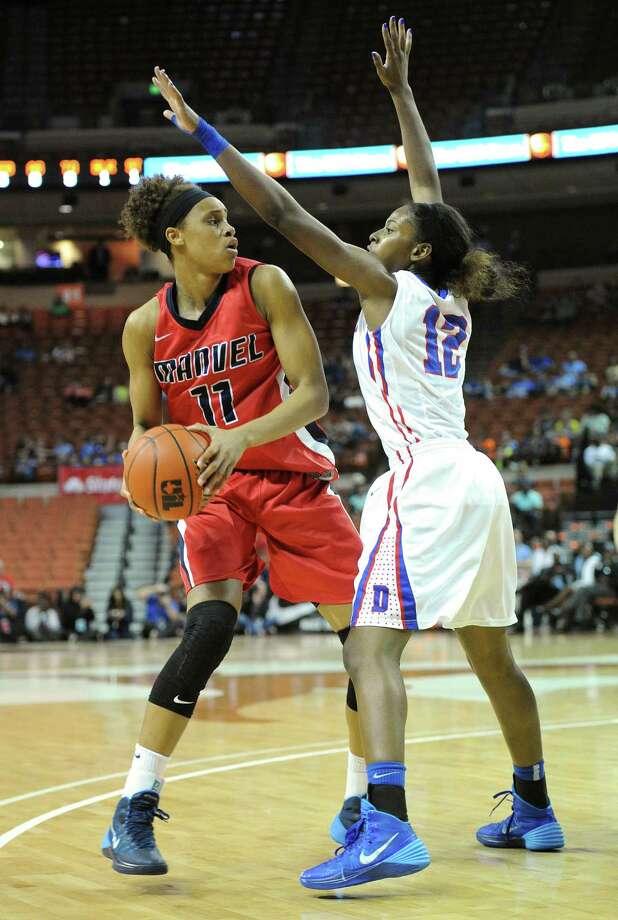 Manvel's Briannna Turner (11) and Duncanville's Ariel Atkins (12) during the UIL 5A state final girls basketball game between Manvel and Duncanville high schools on Sat., March 1, 2014 at the Frank Erwin Center in Austin, TX. Photo: Ashley Landis, Special Contributor / ©Ashley Landis