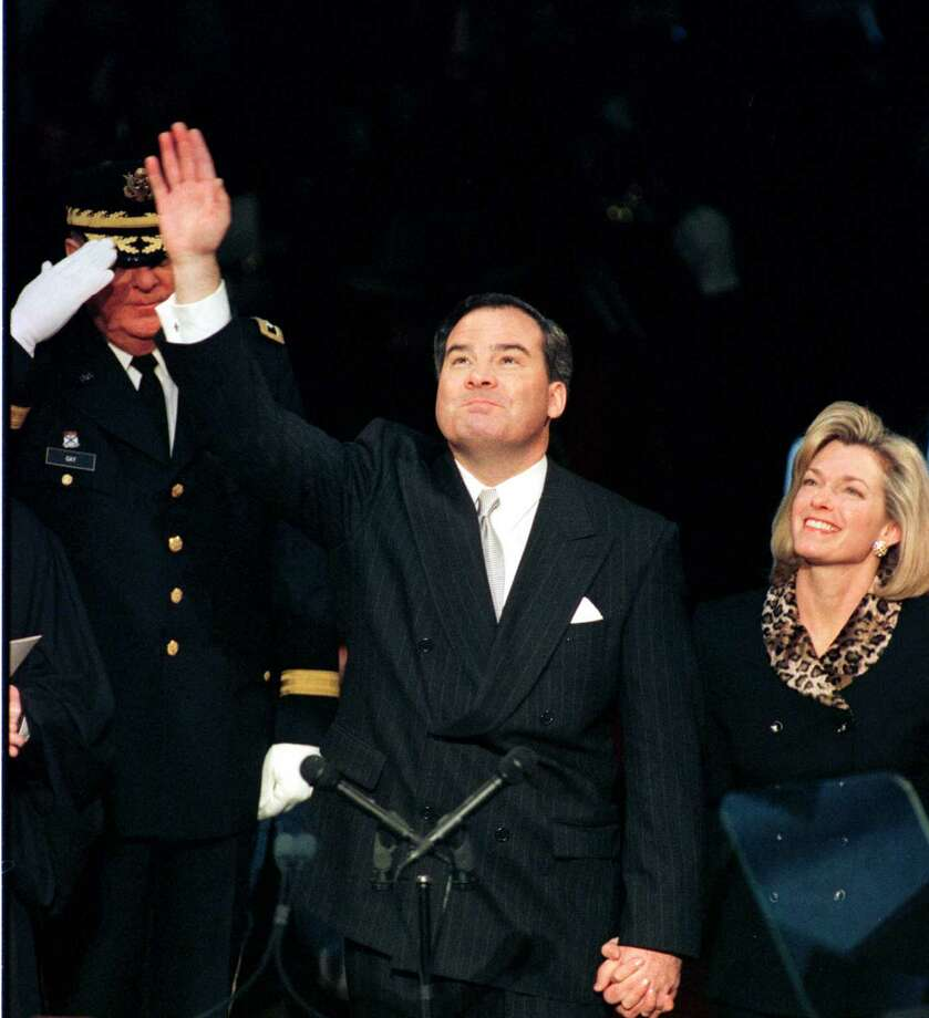 (FILE) Governor John Rowland of Connecticut with his wife Patty Rowland at his side waving to the crowd in the Legislature Office Building before the start of his second Inauguration Wed. Jan 6, 1999.(The News Times Douglas Healey ) Photo: File Photo\Douglas Healey / News-Times
