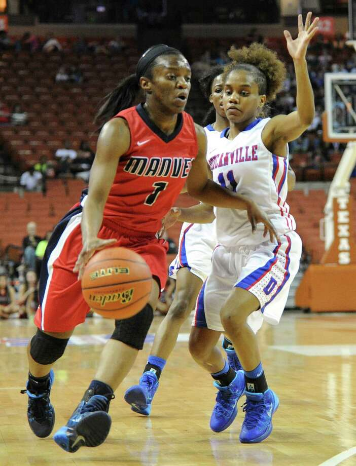 Manvel's Keyerra Fisher (1) and Duncanville's Keyana Smith (11)during the UIL 5A state final girls basketball game between Manvel and Duncanville high schools on Sat., March 1, 2014 at the Frank Erwin Center in Austin, TX. Photo: Ashley Landis, Special Contributor / ©Ashley Landis