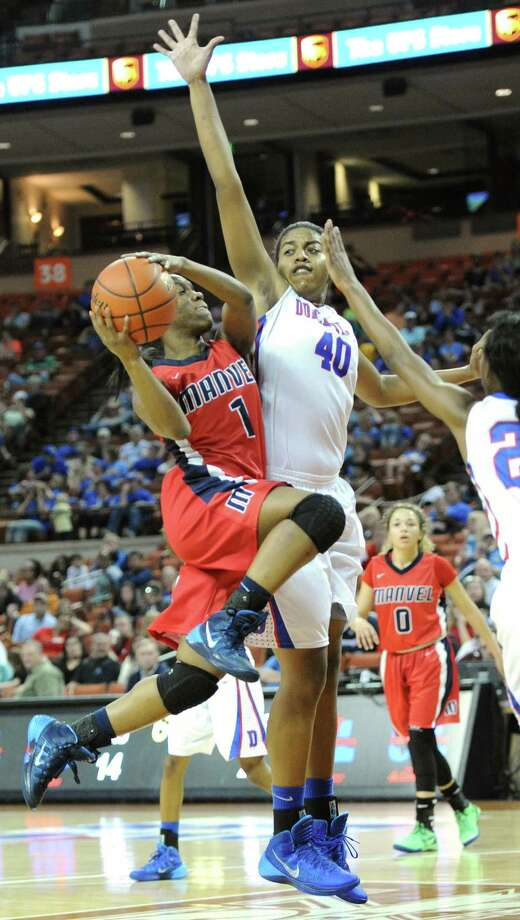 Manvel's Keyerra Fisher (1) and Duncanville's Ciera Johnson (40) and Tasia Foman (20) during the UIL 5A state final girls basketball game between Manvel and Duncanville high schools on Sat., March 1, 2014 at the Frank Erwin Center in Austin, TX. Photo: Ashley Landis, Special Contributor / ©Ashley Landis