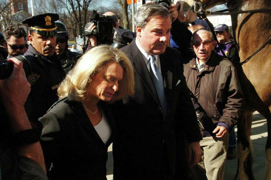 (FILE) Former Connecticut Gov. John G. Rowland and his wife Patty make their way through a crowd while entering U.S. District Court in New Haven, Conn. March 18, 2005. Rowland received a sentence of a year plus one day in prison, four months of home confinement and three years of supervised release on a federal corruption charge. Photo: File Photo, Connecticut Post / Connecticut Post