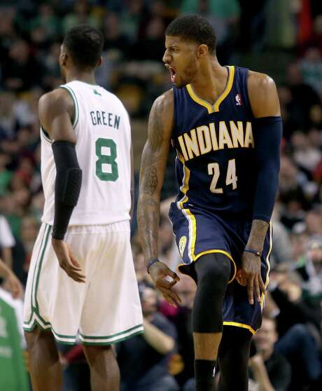 Pacers star Paul George (right) came up big late, scoring 10 of Indiana's final 12 points to survive a scare from the lowly Celtics on Saturday. Photo: Mary Schwalm / Associated Press / FR158029 AP