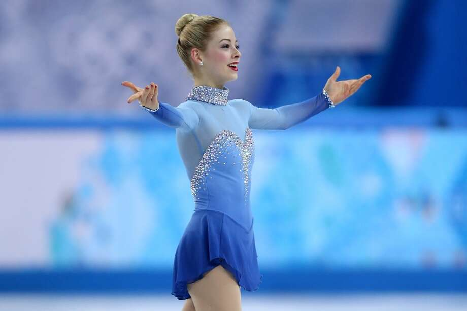BEST: USA's Gracie Gold performed during the short program in blue dress with ombre arms. She looks classic, like Grace Kelly. Photo: Matthew Stockman, Getty Images