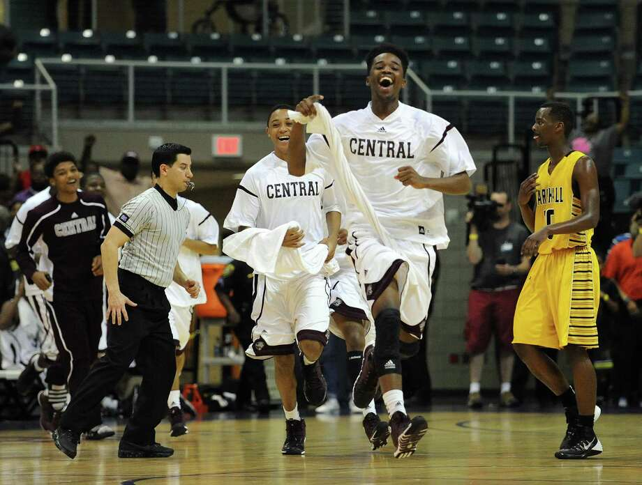 Beaumont Central players celebrate their 67-57 victory over Marshall in the Class 4A Region 3 Final high school basketball playoff game, Saturday, March 1, 2014, at Merrill Center in Katy, TX. (Photo: Eric Christian Smith/For the Chronicle) Photo: Eric Christian Smith, Freelance