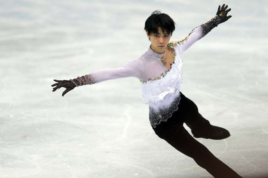 WORST: Black Swan meets Black Sabbath. What was Japan's Yuzuru Hanyu thinking with this ruffle-and Spandex mismatch? It didn't stop him from winning the gold, but he gets major deductions  for his lack of style. Photo: AAron Ontiveroz, Denver Post Via Getty Images